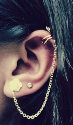 Ear cuff with chain down to a delicate flower earring.