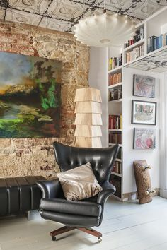 A collection of eclectic titles decorate the living room walls