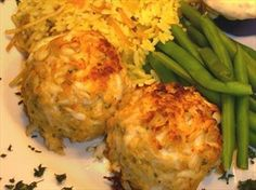 Ruth's Chris Crabcakes!! Garnish with red, yellow, green bell's and serve with fave sauce (lemon juice capers and mayo work well)