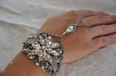 romantic wings swarovski crystal bracelet/ring.  would be cool for a night out!