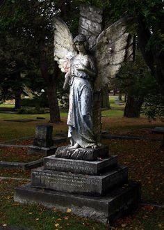 Angel overlooking grave in Ross Bay Cemetery, Victoria, B.C.