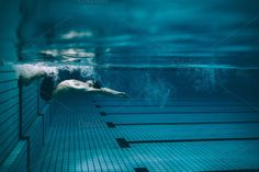 Male #swimmer turning over  by Jacob Lund Photography on @creativemarket