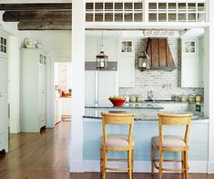 One-Wall Open Kitchen  To open up this small kitchen in an older home, the renovators created a large pass-through in one wall. The peninsula creates a location for casual seating -- a great alternative to putting chairs around an island when space is limited.