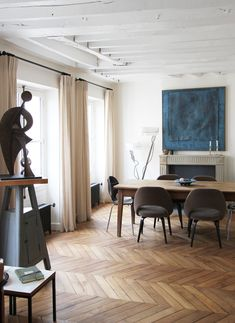 The blog post is about herringbone floors, but all I want to know is where do I find those dining chairs!