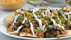 We added enchilada sauce, pickled jalapeño chiles and chopped green chiles to beef nachos for a twist on a traditional Mexican dish.