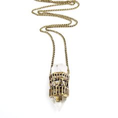 This stunning necklace was handmade using the lost wax casting process. The cage was made by hand in wax, cast in brass, and then set with a