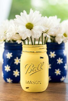 Set of three pint-sized mason jars with 2 hand painted and distressed in cobalt blue with white and yellow daisies and 1 painted & distressed in yellow. Perfect gift idea for Mothers Day or weddings. Great for centerpieces at events, like weddings, baby showers, birthday parties. *