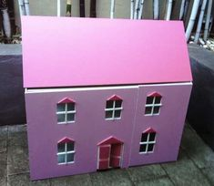 Build a Doll House. Substitute cardboard and paper mache for wood?