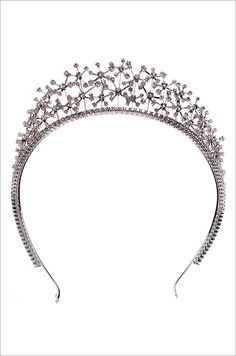 Chopard tiara featuring 326 white diamonds, weighing a total of almost 27 carats, in an 18-karat white gold spray-filigree-style setting. (2009)