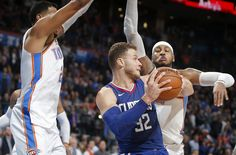 76d431225 Oklahoma City s Carmelo Anthony (7) and Andre Roberson (21) defend LA  Clippers  Blake Griffin (32) during an NBA basketball game between the Oklahoma  City ...