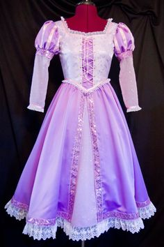 OMG it's like the exact effing dress.... Sparkly RAPUNZEL Tangled Costume Child Custom Size ONLY $360. hahahahaaaaaaaa