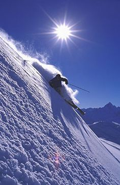 Snow Skiing in the Swiss Alps .