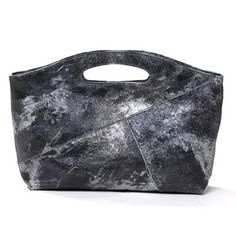 Fashionable and fun, this leather clutch purse in Silver Grey by Daniella Lehavi sets itself apart with its creative splash pattern on the exterior. this designer purse will give a chic elegant look to any outfit.$149.00