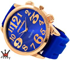 Γυναικείο ρολόι, σε χρυσό και μπλε, με μεγάλα νούμερα στο εσωτερικό του. Λουράκι σε μπλε χρώμα από σιλικόνη. Διάμετρος καντράν 48 mm.