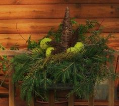 It's too bad the hedge apples rot before Xmas, because I'd really like this centerpiece on top of the entertainment center with some little white lights in it. Apple Decorations, Christmas Decorations, Holiday Decor, Hedge Apples, Flower Boxes, Flowers, Nature Decor, Little White, Outdoor Christmas
