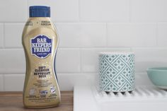 To keep a white ceramic sink (like the IKEA Domsjo) clean and remove scratches, use Bar Keeper's Help.  They wipe right off with little scrubbing!