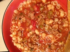 Italian Sausage Soup  4 lb. bulk sausage, browned & drained Saute in olive oil: 1 lg onion, chopped 1 STALK celery, chopped 8 cloves garlic, minced Add sausage & 56 oz crushed tomatoes 28 oz peeled tomatoes Cook over med heat 10 min., then add 2 qt chicken broth 2 tsp ea: oregano, basil, thyme Simmer 30 min. Meanwhile, boil 1 lb small pasta; drain. Put pasta in bowl & top w/soup to serve.