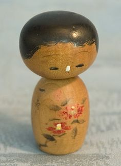 Vintage kokeshi with a white nose