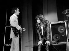 Jim Morrison and Robby Krieger take a breather on stage