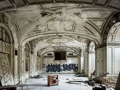 Lee Plaza hotel, built in 1929 and designed by architect Charles Noble. This grand hall with groin-vaulted ceilings, arched entry ways and ornate trim has been abandoned and lost its once stunning charm.
