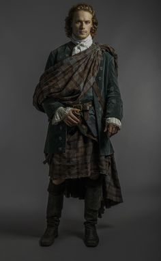 Jamie in wedding clothes, first time we see the Fraser tartan on the show.