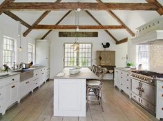 White country kitchen with gable ceiling