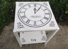 Bespoke side clock table with Latin script.
