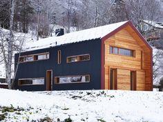 House in Vallée de Joux by Ralph Germann architectes - anthracite metallic shell shields + larch frames