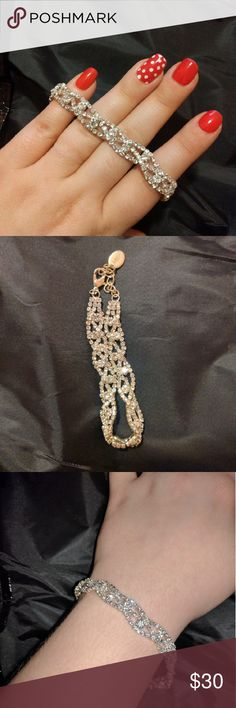 Special Occasion Bracelet Beautiful sparkling cubic zirconia diamonds in a braided pattern to form a glittering non stretch bracelet with lobster clasp and extension chain. Perfect for a party, special event, or wedding. Jewelry Bracelets