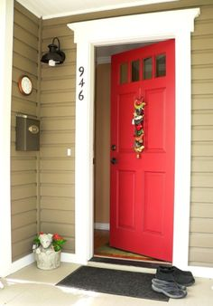 This is our EXACT front door, exact color red, with the white trim.... the brownish tan is tad off, but very similar! I love the black door knob and light fixture with this combo! Great job 946!!!