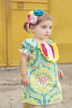 """She used the """"sweet dress"""" pattern described in her blog and tweaked it adding the tuxedo thingie (think I can find a tute to that) and adding tulle around the bottom and arms. VERY CUTE!! And the headband too! This is  the dress for birthday gifts!"""