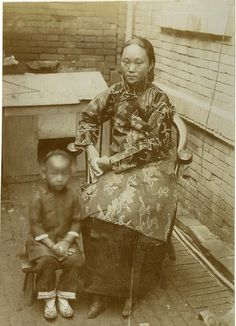 A Chinese woman and her son, circa 1890.