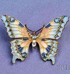 Art Nouveau Sterling Silver, Plique-a-Jour Enamel, and Gem-set Butterfly Pendant/B the plique-a-jour enamel wings with cushion-cut blue stone and seed pearl accents, cabochon red stone eyes. by susanne