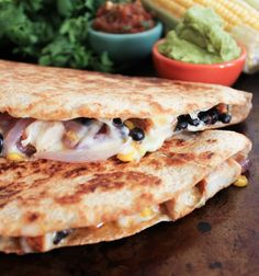 Spicy Chicken Quesadillas with Corn, Black Beans, and Caramelized Onions