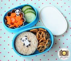 A turkey sandwich cut into a circle with a cute piece of panda bear baran on top. The bottom tier also held some mini pretzel twists. The top tier held a grey silicone muffin cup with sliced baby carrots and a panda pick and a few slices of cucumber. My little guy LOVED it!