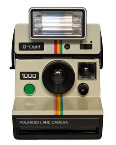 Polaroid Land Camera 1000 & Q-Light electronic flash (front) by Timmy Toucan, via Flickr