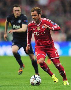 ccf8b01d4c7 Mario Goetze of Bayern Muenchen goes past Phil Jones of Manchester United  during the UEFA Champions