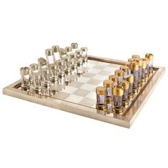 20th Century Design. Chess Set . Bronze, acrylic, brass and plated brass. Height of tallest piece 3 1/2 inches, board 16 3/4 inches square.
