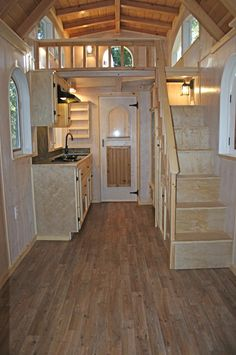 The RV certified tiny house has a 7'x'7 bedroom loft and a 3'x7' storage loft.
