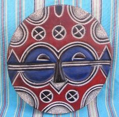 Teke Geometric Disc Wood Mask hand carved in Congo $95.00
