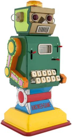 """BATTERY OPERATED ANSWER GAME MACHINE"" BOXED ROBOT."