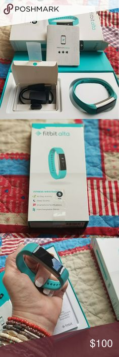 Fitbit Alta Fitbit Alta fitness wristband.  Water resistant,  works with iPhone,  Android,  Windows devices Mac & PC Reach your goals with the fitbit app & dashboard.  Get motivated,  sleep better,  measure exercise,  stay connected,  customize your way,  sync wirelessly.   Stainless steel tracker teal band.   Like brand new.   Bought for my daughter and only worn a few times.  Original box and all original hardware. Charger cord,  USB included. Fitbit Alta Accessories Watches
