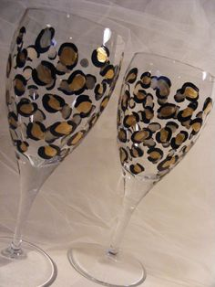 pair of handpainted leopard print wine glasses - can be customized in your wedding colors - perfect for bridesmaids. $25.00, via Etsy.