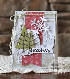 Die cut Christmas card with snowflakes and trees.