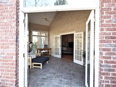 Tiled under-roof sunroom with French doors to great room, Master bedroom and brick patio