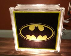 Batman hand crafted lighted glass block The front of the block is hand polished to a glossy finish The light bulb is a standard night light bulb so it can Glass Cube, Glass Boxes, Glass Art, Decorative Glass Blocks, Lighted Glass Blocks, Movies Costumes, Bat Pics, Batman Light, Nananana Batman
