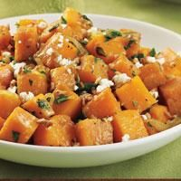 Sweet Potato & Kale Hash sprinkled with goat cheese and chopped pecans