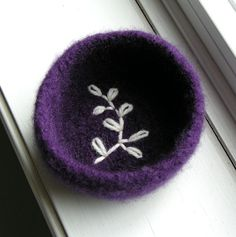 Felted wool bowl with an embroidered fern silhouette in the bottom