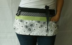 Utility Apron/Half Apron with 8 pockets and loop in black white and light green floral fabrics. $35.00, via Etsy.