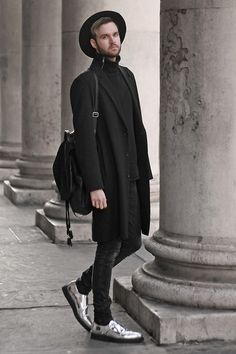 Get this look: http://lb.nu/look/7936770  More looks by Geraint Donovan-Bowen: http://lb.nu/hisnameisfashion  Items in this look:  Topman Fedora, H&M Roll Neck, River Island Duster Coat, Rokit Backpack, Open Jeans, Underground Shoes   #chic #minimal #street